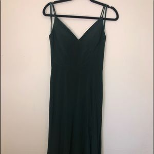 Dark green formal dress with a high leg slit